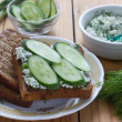 Sandwich with cottage cheese, cucumber and dill — Stock Photo #46557093