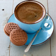 A cup of black coffee and chocolate biscuits — Stock Photo #46557803