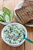 Cottage cheese with chives, garlic and dill — Stock Photo