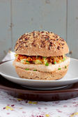 Vegetarian burgers with wholegrain buns, tofu and vegetables — Stock Photo