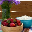 Strawberries in the wooden bowl and cottage cheese — Stock Photo #48100495