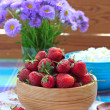 Strawberries in the wooden bowl and cottage cheese — Stock Photo #48100681