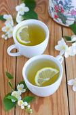 Green tea with jasmine and lemon — Stock Photo