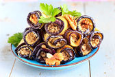 Eggplant rolls with walnut and garlic — Stock Photo