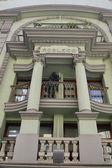 Building with green facade — Stock Photo