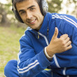 Young man enjoying listening to music on tablet — Stock Photo #46306735