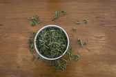 Bowl with rosemary — Stock Photo