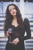 Beautiful girl with red lipstick and glass of red wine — Stockfoto