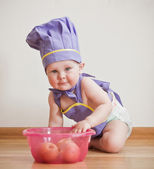 Baby-boy in a chief hat at the kitchen — Stock fotografie