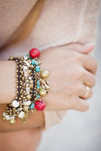 Colorful bracelet with shells and bells — Stock Photo