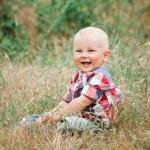 Fashion baby boy walking in grass — Stock Photo #47457383