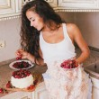 Young beautiful woman making cake at the kitchen — Stock Photo #48362239