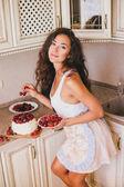 Young beautiful woman making cake at the kitchen — Stock Photo