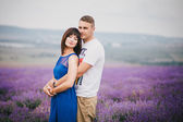 Young couple in the lavender field — Stockfoto