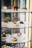 Cakes and desserts in a shop window — Stock Photo