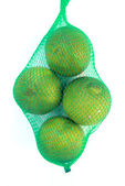 Grapefruits hanging in the mesh bag — Stockfoto