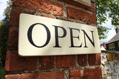 Open Sign on Brick Wall — Stock Photo