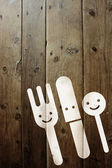 Fork, knife and spoon on a wall — Stockfoto
