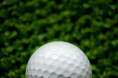 Golf ball on green background — Stock Photo