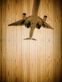 Airplane on Wooden background — Stock Photo
