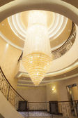 Large chandelier in the middle of spiral staircase — Stock Photo