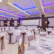 Banquet hall with colorful lights — Stock Photo #51097627