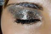 Glittery silver eye makeup — Stock Photo