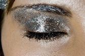 Glittery silver eye makeup — Stock Photo