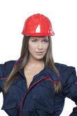 Självsäker kvinna i industriella uniform — Stockfoto
