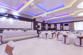 Banquet hall with colorful lights — Stock fotografie