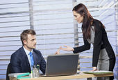 Two business people arguing in office — Stock Photo