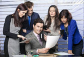 Business leader surrounded by dedicated team — Stock Photo