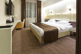 Interior of a double bed hotel room — Stock Photo