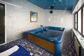 Big jacuzzi tub in hotel spa center — Stock Photo