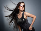 Young beautiful girl in sunglasses. — Stock Photo