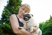 Young woman hugging her dog — Stock Photo