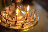Burning candles in ortodox church — Stock Photo
