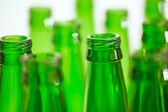 Composition with ten green beer bottles, but only two bottles in — Stock Photo