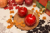 Two apple in red caramel on the table — Stock Photo