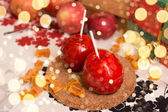 Two apple in red caramel on the table - composition with sparkli — Stock Photo