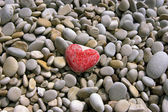 Heart on the sea pebble — Stok fotoğraf