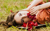 Sexy Model lying on grass — Stock Photo