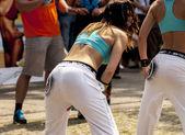 Sexy students dance zumba class — Stock Photo