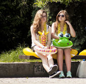 Two college girls with beach toys — Stock Photo