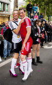 Gay couple in heels, dressed as football players. — Stock Photo