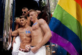 Participants at the gay pride posing for pictures — Stock Photo