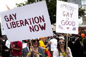 Two participant of gay pride parade with placards — Stock Photo
