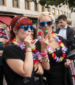 Elaborately dressed girls during gay pride parade — Stock Photo