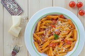 Fresh pasta with tomatoes, parmesan cheese and wine — Stock Photo