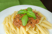 Penne with bolognese sauce — ストック写真